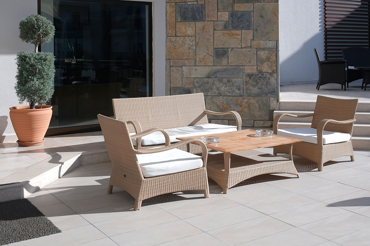Wicker furniture chairs couch and table in seating louge with ceramic tile patio decor