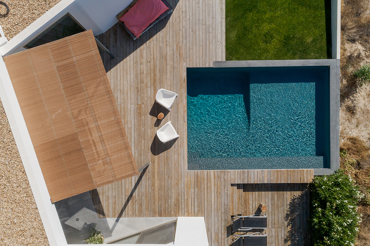 Aerial view of modern house with garden swimming pool and wooden deck